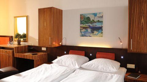 Modern eingerichtete Zimmer mit hochwertiger Ausstattung
