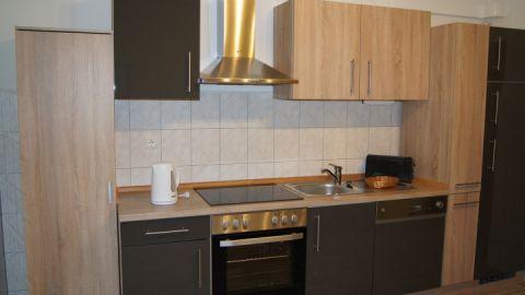 Unsere Küche bietet neben Herd und Kühlschrank auch eine Spühlmaschine